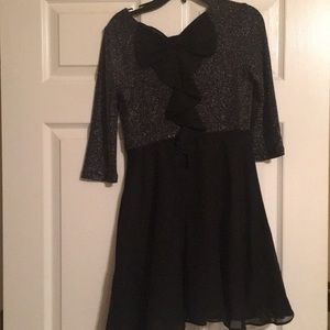 Girls black dress with bow in back.